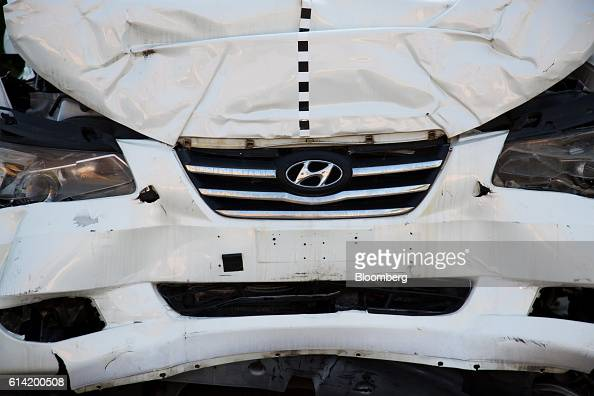 A damaged Hyundai Motor Co vehicle used for crash testing stands at the Korea Automobile Insurance Repair Research and Training Center operated by...