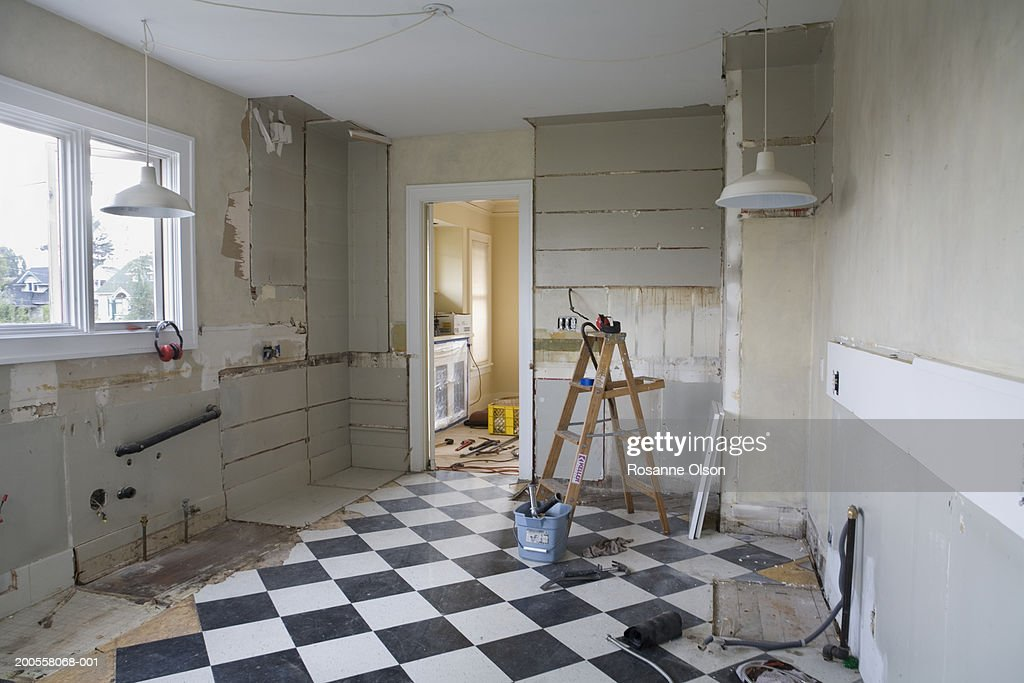 Damaged kitchen interior before restoration
