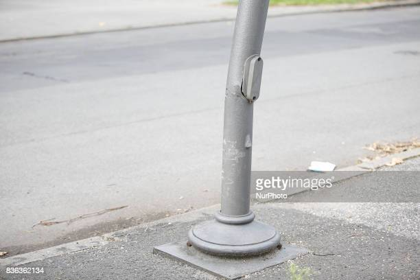 A damaged lamp post is seen near a parking space on 19 August 2017