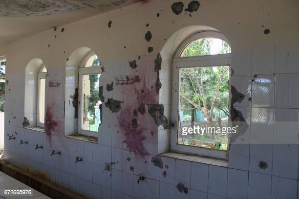 A damaged mosque is seen on the grounds of an army compound outside MazariSharif in Balkh province on April 25 following the deadly assault by...