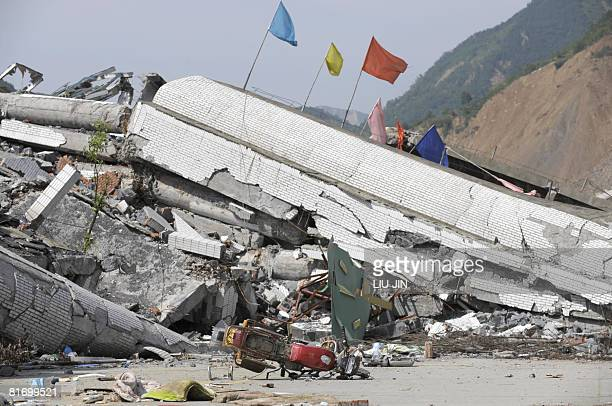 A damaged motorbicycle lies before a collapsed building along a street in the worst earthquakehit area of Beichuan county in China's southwestern...