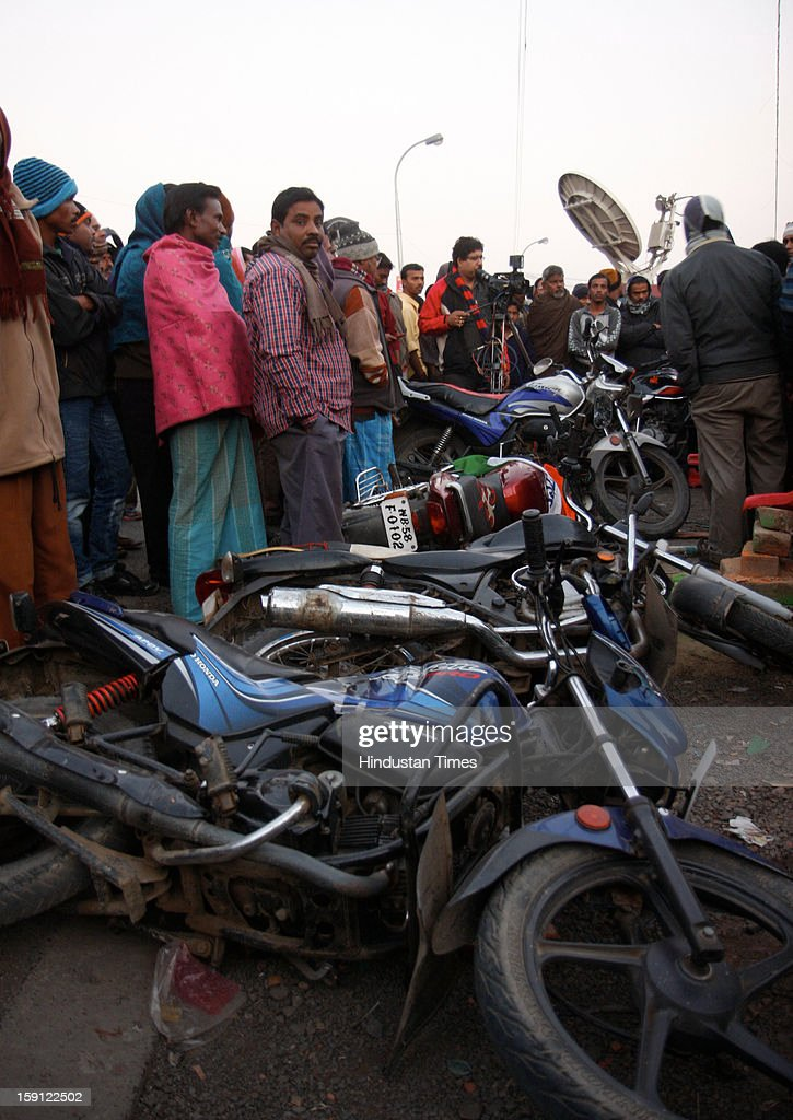 Damaged motorcycles are lying in front of Bamanghata TMC Party Office after the clash with CPI(M) on on January 8, 2013 in South 24 Parganas, India. A large number of vehicles were reportedly torched while more than dozen of cadres from both parties were injured in clash using firearms and stones. Reportedly convoy of Marxist leader Abdur Rezzak Mollah was attacked by TMC former MLA Arabul Islam leading to violent clash between cadres of two parties.