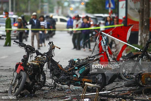 Damaged motorcycles that were burnt in a fire that started in a karaoke bar are seen in Hanoi on November 2 2016 A fire at a karaoke bar killed 13...