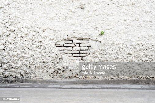 Damaged of white brick wall : Stock Photo