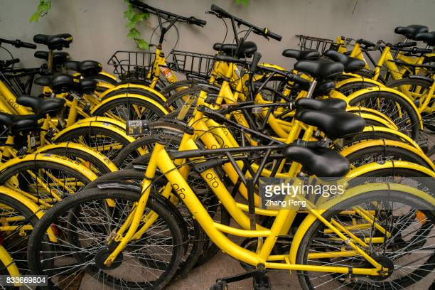 Damaged OfO shared bikes are abandoned at roadside The rapid development of sharing bicycles brings new problems to city management