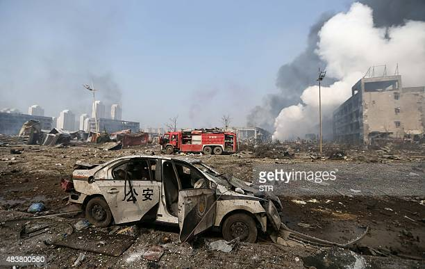 A damaged police car is seen at the site of the massive explosions in Tianjin on August 13 2015 Enormous explosions in a major Chinese port city...