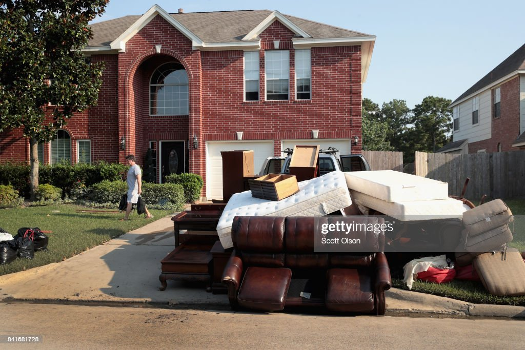 Damaged possession are left at the curb as residents recover from damage to their homes after torrential rains caused widespread flooding during Hurricane and Tropical Storm Harvey on September 1, 2017 in the Atascocita subdivision in Humble, Texas. Harvey, which made landfall north of Corpus Christi on August 25, dumped around 50 inches of rain in and around areas of Houston and Southeast Texas.