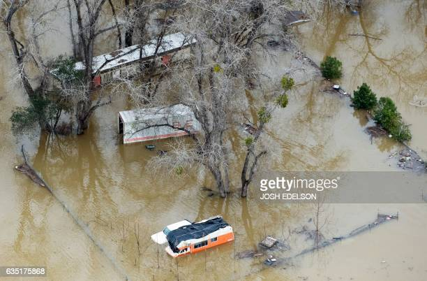 A damaged property is seen under flood waters in Oroville California on February 13 2017 Almost 200000 people were under evacuation orders in...
