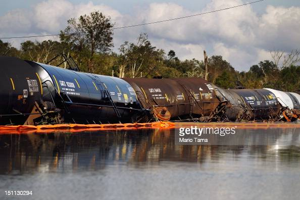 Damaged railroad cars sit in Hurricane Isaac's flood waters on September 1 2012 in Braithwaite Louisiana Louisiana residents continue to cope with...