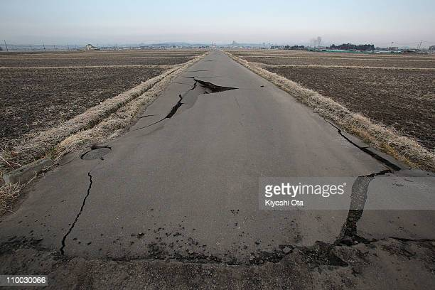 A damaged road is seen after an 89 magnitude strong earthquake struck on March 11 off the coast of northeastern Japan on March 13 2011 in Sendai...