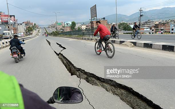 Damaged roads are seen after an earthquake on the outskirts of Kathmandu on April 26 2015 International aid groups and governments intensified...