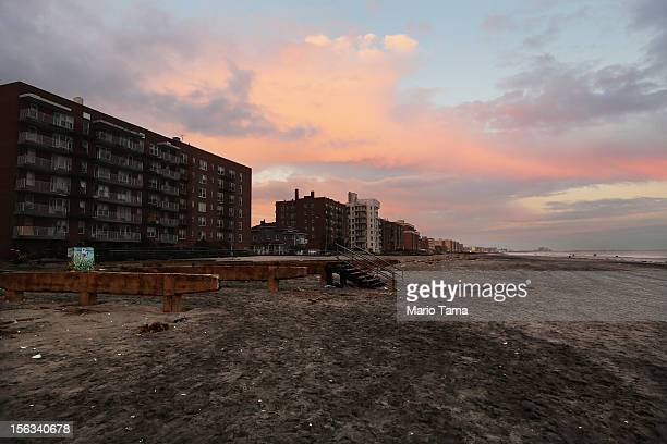A damaged section of beach with missing boardwalk is seen at sunset in the Rockaway neighborhood on November 13 2012 in the Queens borough of New...