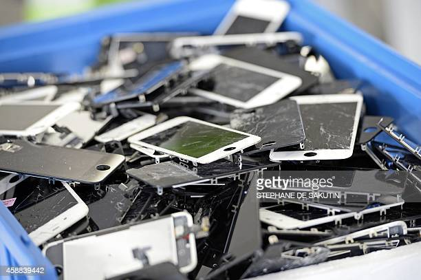 Damaged smartphones are pictured on November 7 2014 in Paris at the 'Allo Smartphone' company The company collects and repairs all kind of...