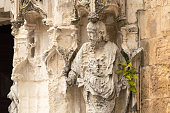 Damaged statue (acid rain) at the entrance of the Igreja de Santa Cruz, Coimbra, Portugal. The church is part of a monastery. The Santa Cruz monastery is one of the most fascinating religious building