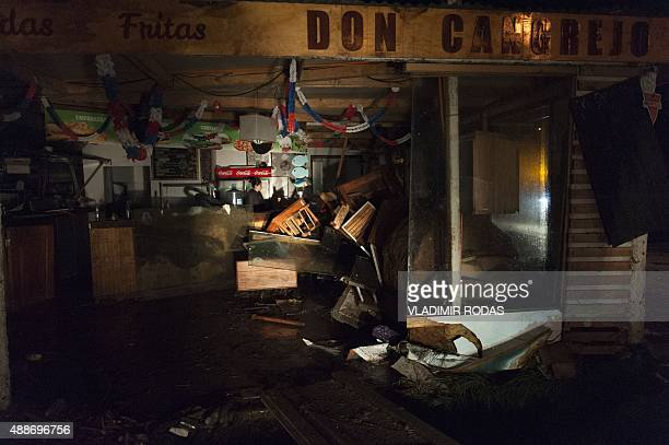A damaged store is seen after a large earthquake in Concon some 110 kms northwest of Santiago on September 16 2015 The 83magnitude earthquake that...