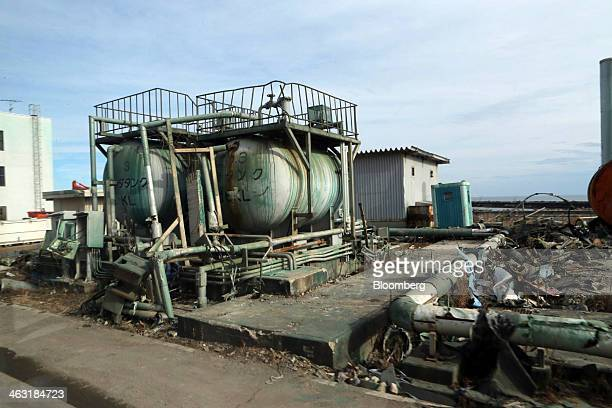Damaged tanks seen through a window sit on the side of a road at Tokyo Electric Power Co's Fukushima DaiIchi nuclear power plant in Okuma Fukushima...