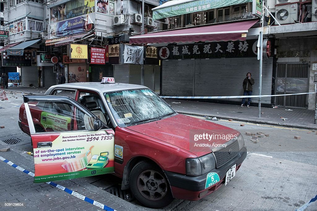 A damaged taxi is seen after the riots occurred in the Mongkok district of Hong Kong on February 9, 2016 in Hong Kong, China. More than 40 police officers and journalists have been injured after a riot with protesters on the first day of Chinese New Year celebrations.