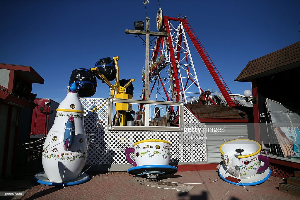 A damaged tea cup ride sits at the Fantasy Island Amusement park that was flooded by Superstorm Sandy, on November 24, 2012 in Long Beach Island, New Jersey. New Jersey Gov. Christie estimated that Superstorm Sandy will cost New Jersey $29.4 billion in damage and economic losses.