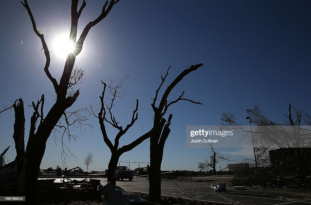 Damaged trees are seen in the parking lot of the Canadian Valley Technology Center after a series of tornadoes that ripped through the area a day earlier on June 1, 2013 in El Reno, Oklahoma. A series of tornadoes ripped through the area on Friday evening killing at least nine people, injuring many others and destroying homes and buildings.