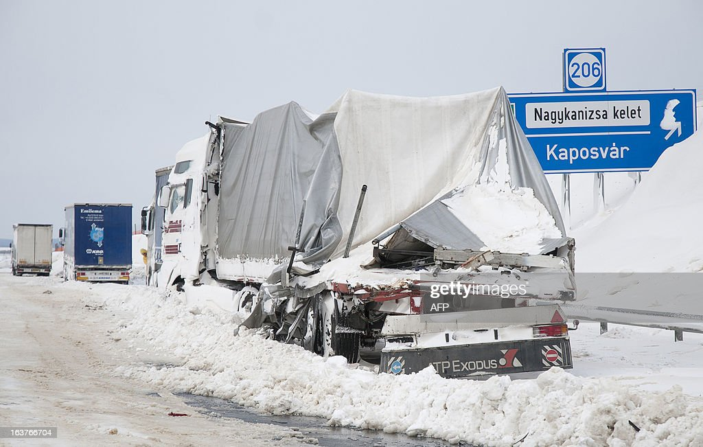 A damaged truck stands at the site of an accident at the E71 motorway, nearby the Croatian, Slovenian and Hungarian borders on March 15, 2013 a day after a heavy snow storm hit the area. A cold snap that caused havoc elsewhere in Europe sent temperatures plunging and blanketed large parts of Hungary in snow, causing major transport problems and leaving tens of thousands without electricity.