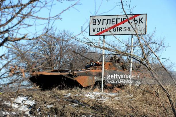 A damaged Ukrainian Army armored personnel carrier sits near Uglegorsk 6 kms southwest of Debaltseve on February 18 2015 Ukrainian troops pulled out...