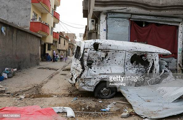 A damaged van is seen after the clashes between Turkish forces and militants of the Kurdistan Workers' Party in the Kurdishmajority city of Cizre in...