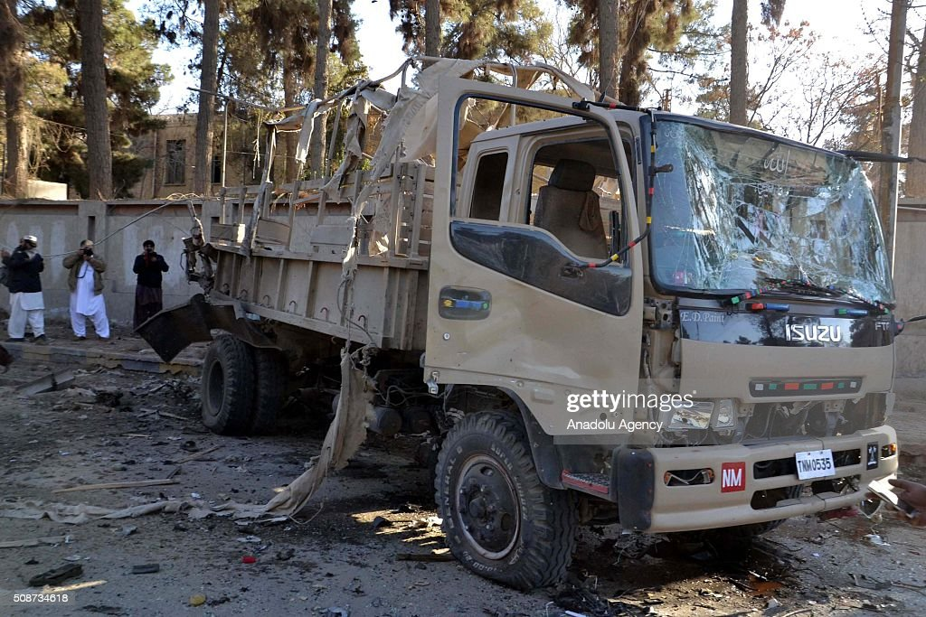 A damaged vehicle is seen at the site of a suicide attack in Quetta, Pakistan, on February 6, 2016. At least nince people were killed and several others wounded in the suicide attack near the premises of the heavily guarded Quetta district courts on Saturday.