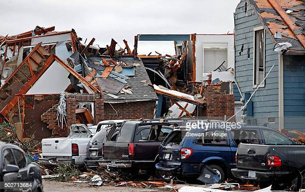 Damaged vehicles and apartments buildings are seen at the Landmark at Lake View North Apartments as the recovery process begins following tornadoes...