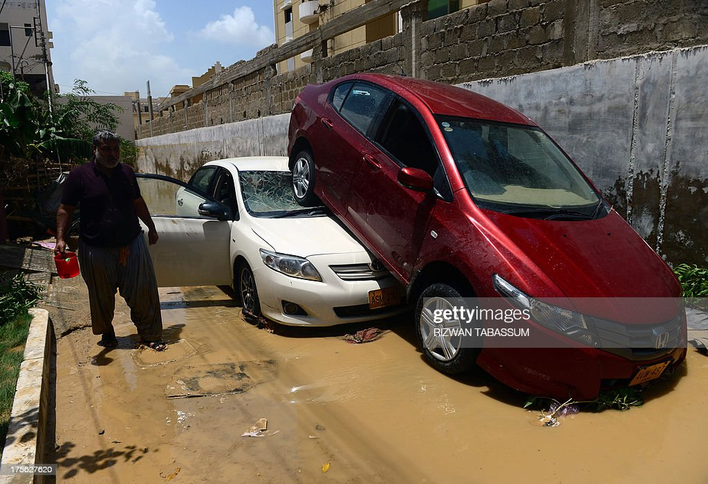 Damaged vehicles are pictured in the aftermath of floods at a residential area of Karachi on August 5, 2013. Pakistani disaster relief officials issued fresh flood warnings after the death toll from heavy monsoon rains rose to 45 and waters paralysed parts of the largest city Karachi. Flash floods caused by monsoon downpours have inundated some main roads in the sprawling port city and swept away homes in the northwestern province of Khyber Pakhtunkhwa.
