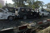 Damaged vehicles of foreign troops are seen at the site of a suicide attack in Kabul on September 16 2014 A large blast ripped through central Kabul...