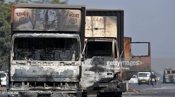 Damaged vehicles on National Highway 1 at Murthal town after Jat protests for reservation in government services turned violent on February 23 2016...