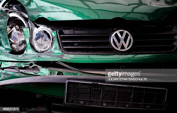 A damaged Volkswagen car stands on the grounds of a scrap dealer in Hanover central Germany on September 22 2015 Share prices on the Frankfurt stock...