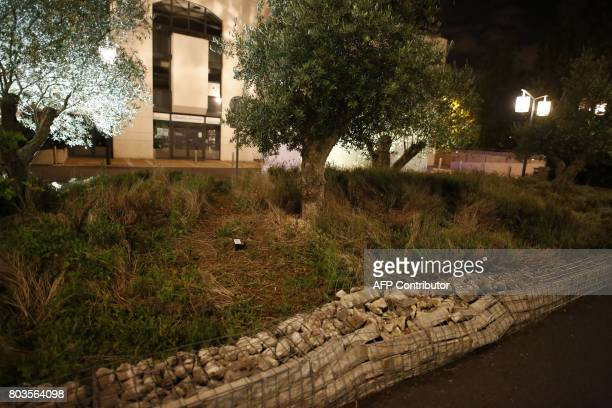A damaged wall outside a mosque in the Paris suburb of Creteil is seen June 29 2017 after a man tried to drive a car into a crowd in front of the...