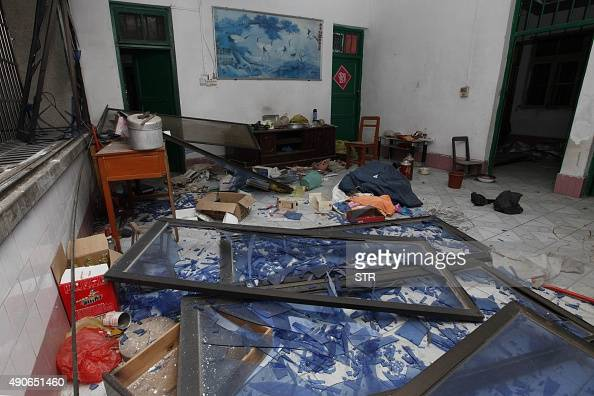 Damaged windows are seen on the ground of a room at the site of blasts in Liucheng county in Liuzhou in south China's Guangxi province on September...