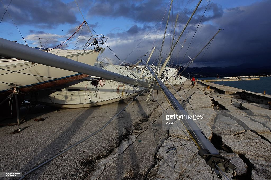 Damages are seen in the port of the city of Lixouri, one day after a strong 6.1 magnitude earthquake hit the island, on February 4, 2014. A strong earthquake hit the Greek island of Cephalonia early on February 3 , causing further damage to homes and public buildings a week after another major tremor The quakes have cracked the wharf of Lixouri and surrounding roads and disrupted the electricity supply. The island's schools are temporarily shut.
