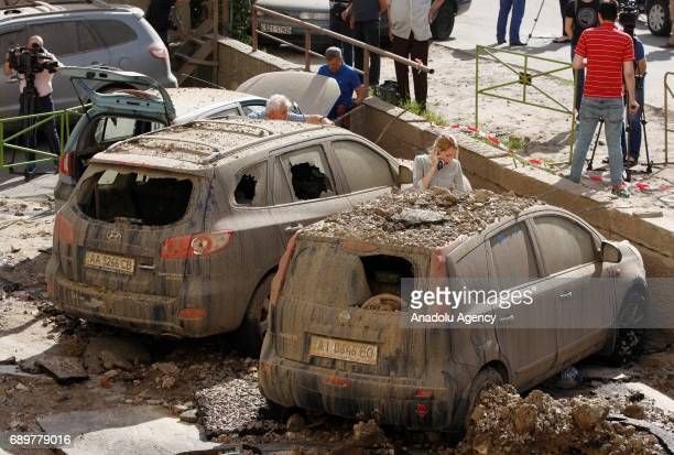 Damages caused by an accident on the water pipeline are seen in Kiev Ukraine on May 29 2017 While running hydraulic tests on a water pipeline at the...