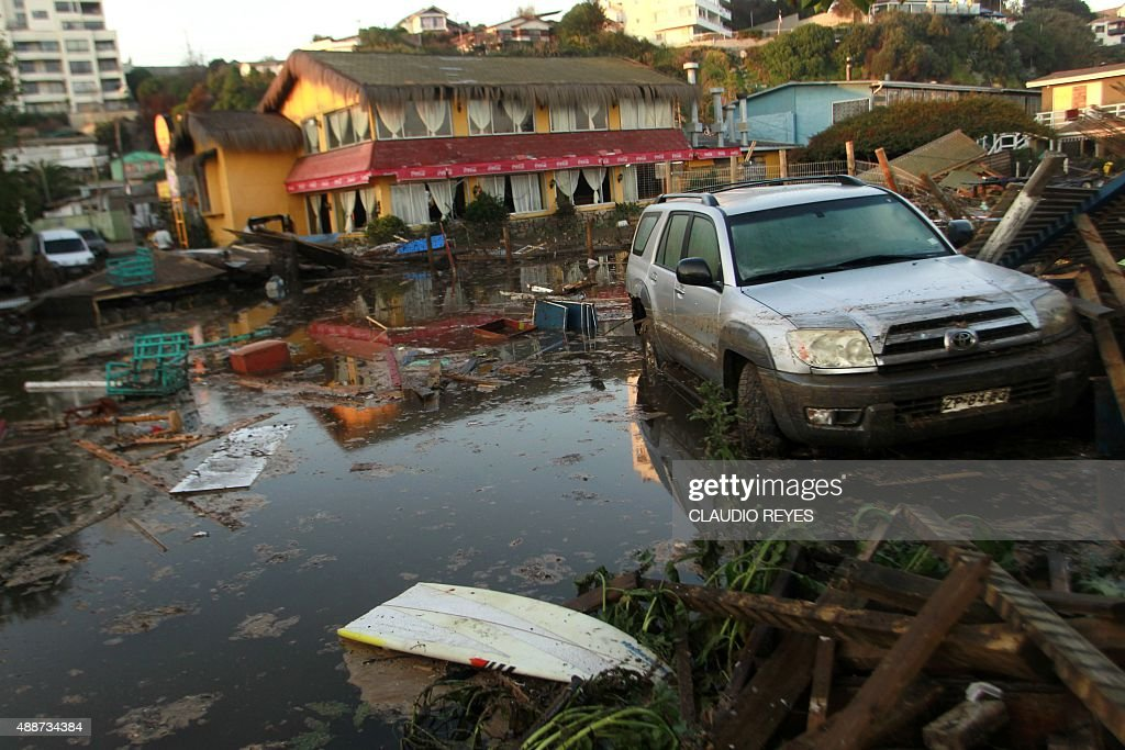 Damages on a street of Concon some 110 km northwest of Santiago on September 17 2015 hit by an earthquake on the eve A powerful 83magnitude...