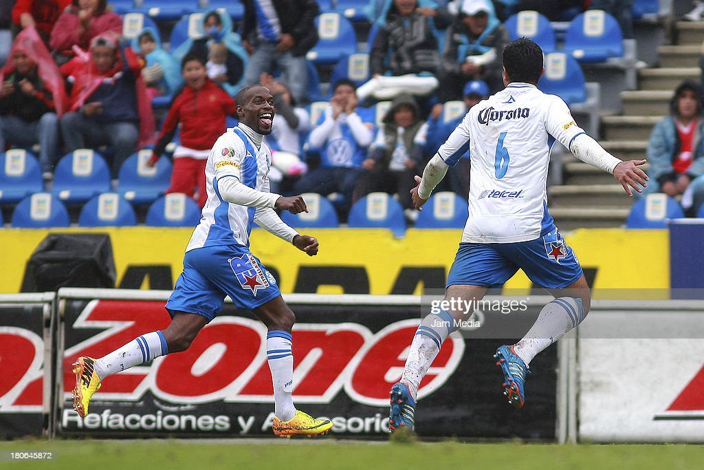 Damarcus Beasley (L) of Puebla celebrates score a goal against Toluca during a match as part of Apertura 2013 Liga MX at Cuauhtemoc Stadium on September 14, 2013 in Puebla, Mexico.