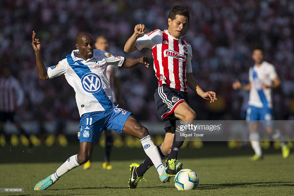 Damarcus Beasley (L) of Puebla fights for the ball with Erick Torres (R) of Chivas during a match between Puebla and Chivas as part of the Clausura 2013 at Cuauhtemoc Stadium on February 17, 2013 in Puebla, Mexico.