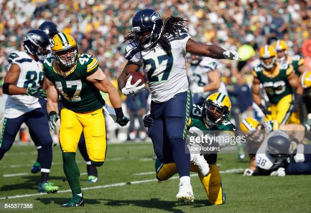 Damarious Randall of the Green Bay Packers attempts to tackle Eddie Lacy of the Seattle Seahawks during the first half at Lambeau Field on September...