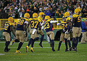Damarious Randall of the Green Bay Packers celebrates with members outfield the Packer defense after making a defensive stop on 4th down against the...