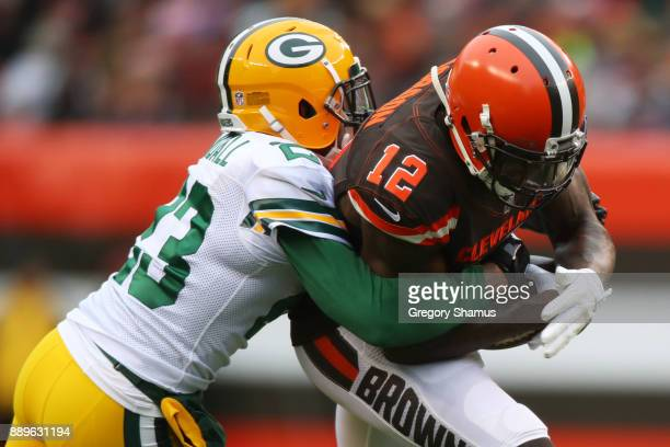Damarious Randall of the Green Bay Packers tackles Josh Gordon of the Cleveland Browns in the second quarter at FirstEnergy Stadium on December 10...