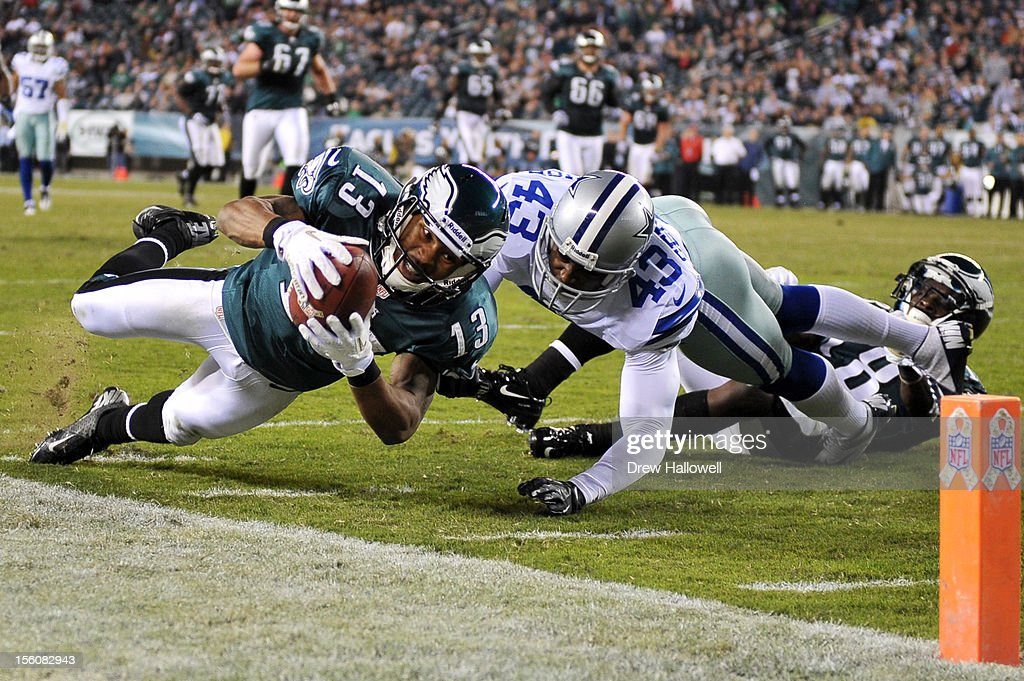 Damaris Johnson #13 of the Philadelphia Eagles dives for the end zone past <a gi-track='captionPersonalityLinkClicked' href=/galleries/search?phrase=Gerald+Sensabaugh&family=editorial&specificpeople=1046355 ng-click='$event.stopPropagation()'>Gerald Sensabaugh</a> #43 of the Dallas Cowboys at Lincoln Financial Field on November 11, 2012 in Philadelphia, Pennsylvania. The Cowboys won 38-23.