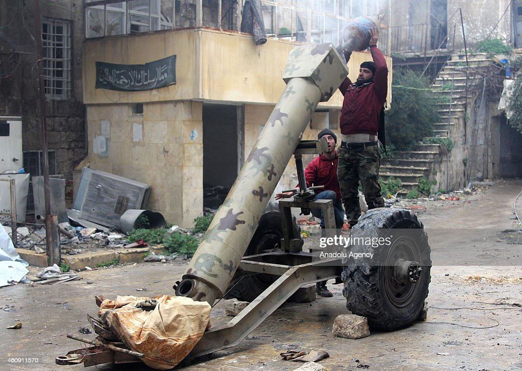 Damascus Front forces fire rockets and howitzers, made up by propane cylinder and named 'hell', around the Citadel of Aleppo during the clashes against regime forces in Aleppo, Syria, on December 30, 2014. Damascus Front members arrive at depot of Assad forces by the way of tunnel and at least 15 regime forces killed.