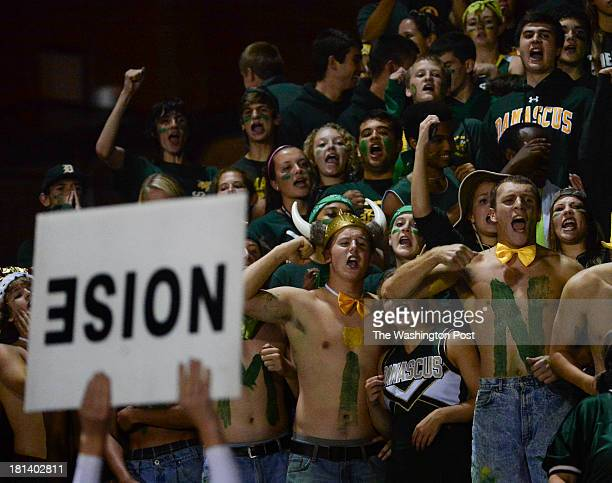 Damascus High School students cheer on their team during the game between Quince Orchard High School and Damascus High School at Damascus High School...