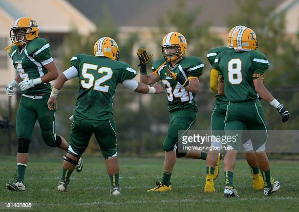 Damascus High School's Zach Greenberg center left congratulates his teammate Jake Funk center right after Funk intercepted the ball during the game...