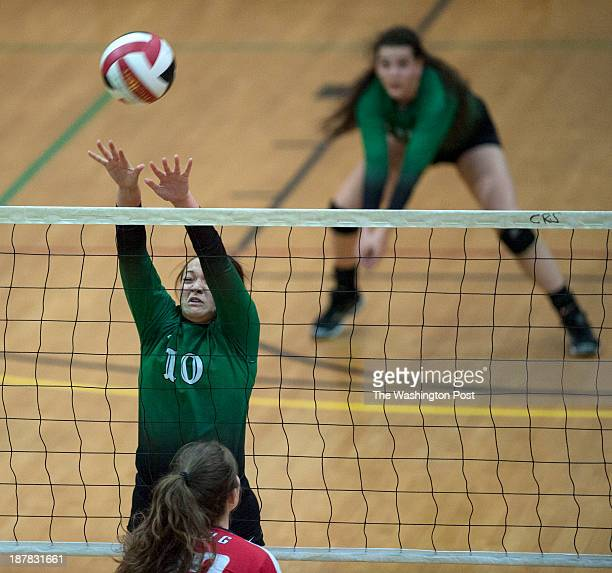 Damascus junior Hunter Smith goes up for the block against Glenelg during the Maryland 3A volleyball state semifinals at Maryland's Ritchie Coliseum...