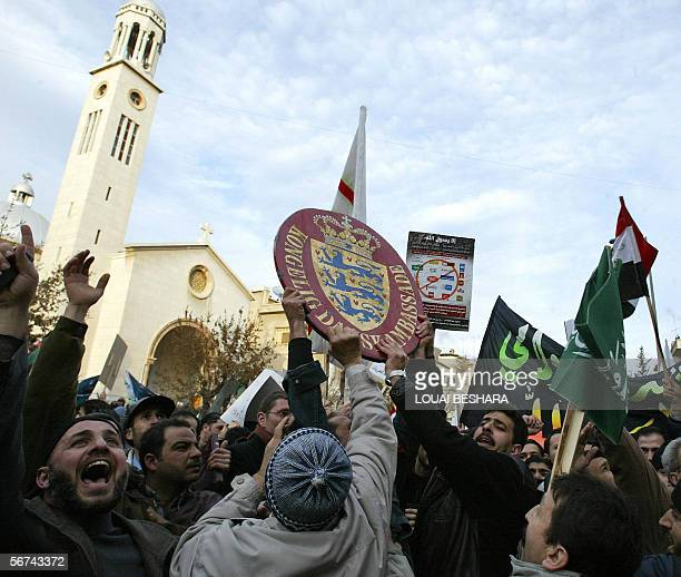 Angry demonstrators hold up the Danish coat of arms ripped from Denmark's embassy in Damascus 04 February 2006 Demonstrators angered over cartoons of...