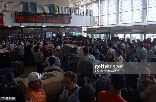 Scores of passengers wait at the Departure hall of Damascus airport 19 July 2006 Lebanon's national carrier Middle East Airlines announced today it...