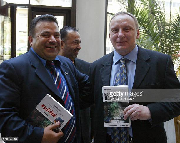 Syrian lawyer Hossam Aldin alHabash poses with his client German journalist Jurgen Cain Kulbel who wrote a book titled 'Mordakte Hariri Unterdruckte...